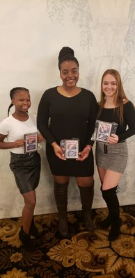 Southampton girls basketball players Maddie Taylor, left, Allysha Thomas and Taylor Pike with their postseason awards this past winter.
