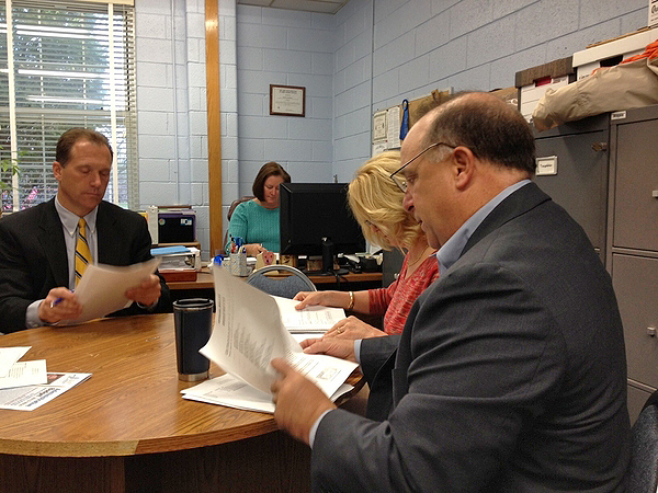 Members of the Remsenburg-Speonk Board of Education at a special meeting to adopt the 2013-2014 budget. ERIN MCKINLEY