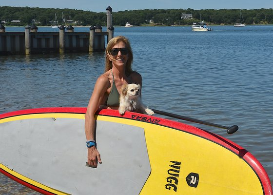 Paddle Diva, which operates out of Shagwong Marina in Springs, is suing over a town ruling that it is violating zoning by using the marina as its base of operations. KYRIL BROMLEY