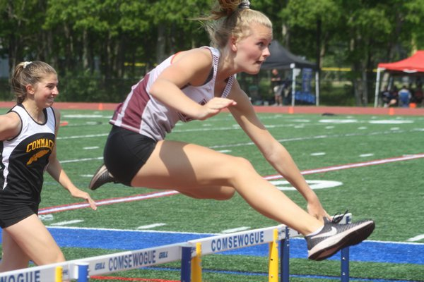 Hanna Medler competing in the 100 meter hurdles as part of the pentathlon at the state qualifier meet at Comsewogue High School on Friday. CAILIN RILEY
