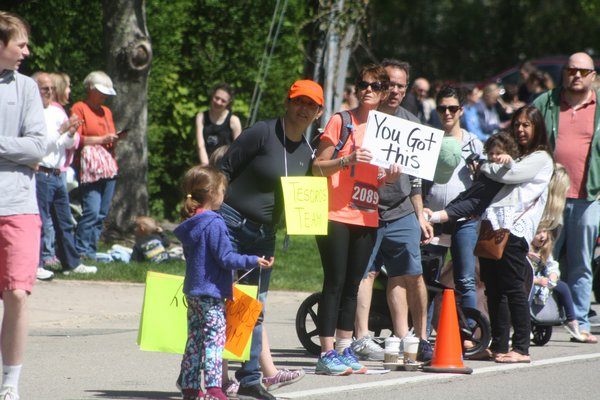 Spectators cheer on the runners as they approach the finish line.   CAILIN RILEY