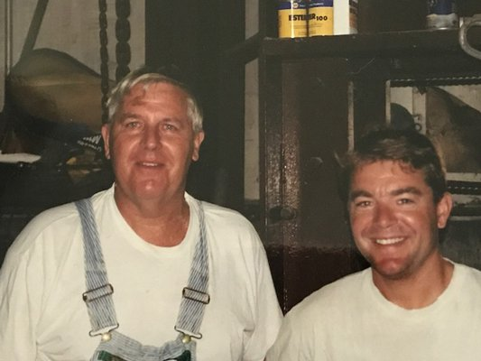 Cliff Foster and his son, Dean Foster, who took over operation of Foster Farm in 2001.