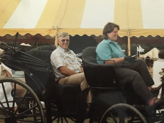 Cliff Foster at the Hampton Classic Horse Show in a carriage driven by his oldest daughter, Robin Foster.