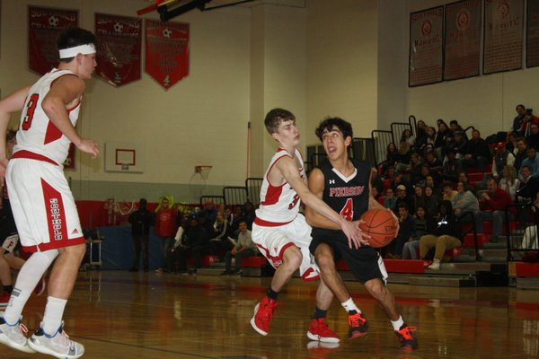 Peter Schaefer drives to the hoop in Pierson's loss to Southold. CAILIN RILEY