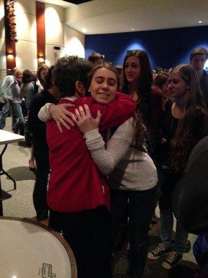 Lauren Capozzola, 16, hugs Bozenna Urbanowicz Gilbride, a Polish Holocaust survivor, after hearing her presentation at the Westhampton Beach High School on Tuesday. BY CAROL MORAN