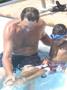 Kurt Billing gives a swim lesson to a Fresh Air Fund kid last summer.