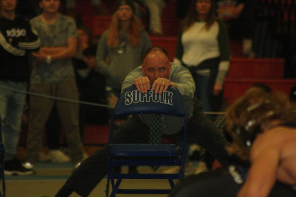 Westhampton Beach head coach Paul Bass tries to corral his emotions while watching sophomore Jackson Hulse in the final moments of his 4-3 win in the 160-pound championship bout. CAILIN RILEY