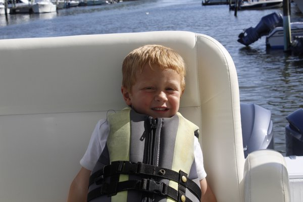 Chris Desantis takes a ride on his dad's 40-foot boat in Moriches Bay. KATE RIGA