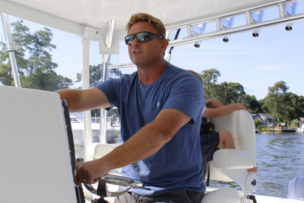 Gregg Desantis, Center Moriches boater and resident, takes his 40-foot boat out for a ride in Moriches Bay. KATE RIGA