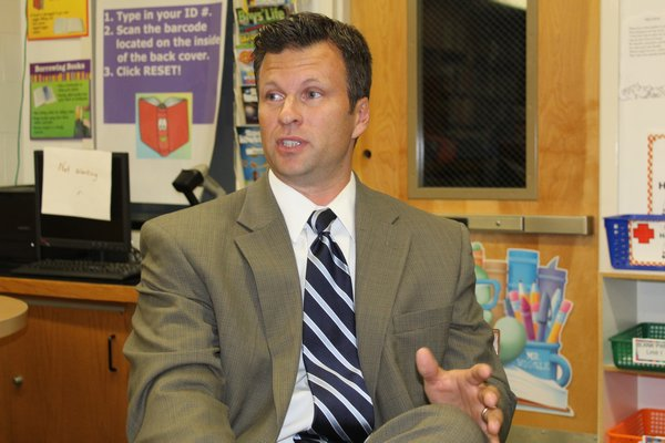 Westhampton Beach high school principal Christopher Herr makes a point in favor of eliminating class rank. KATE RIGA