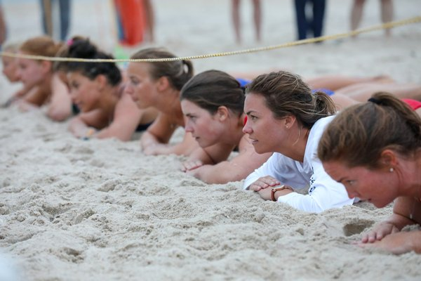 Female guards get set for the beach flags event.