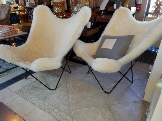 Iconic Knoll Butterfly Chairs with sheepskin give these classics an updated chic look and saves you from having them reupholstered. JACK CRIMMINS
