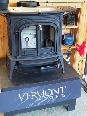 This Vermont Castings wood stove puts out 37,000 BTUs at 77 percent efficiency and already meets the 2020 EPA emission standards. Great for a small house, cabin or large room. The ash pan under the stove makes cleaning real easy and the griddle top can be used for cooking or heating food. Cost is around $2,200 plus installation. ANDREW MESSINGER