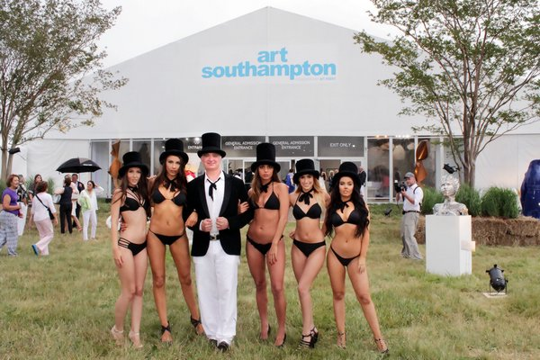 Artist Kevin Berlin and his top hatted entourage TOM KOCHIE