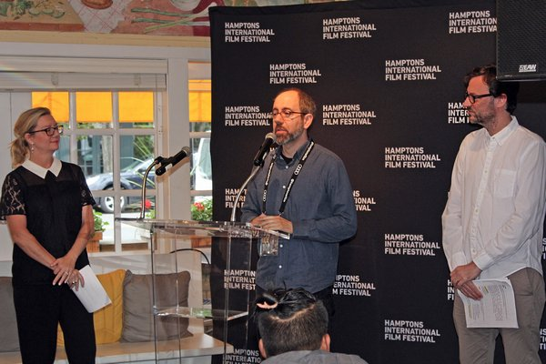 """Director Robert Behar accepting the Victor Rabinowitz and Joanne Grant Award for Social Justice for """"The Silence of Others."""" TOM KOCHIE"""