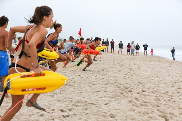 Lifeguards head into the surf for the landline rescue.