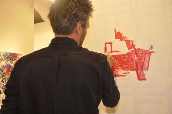 RERO draws with red lipstick at Art Southampton. MICHELLE TRAURING