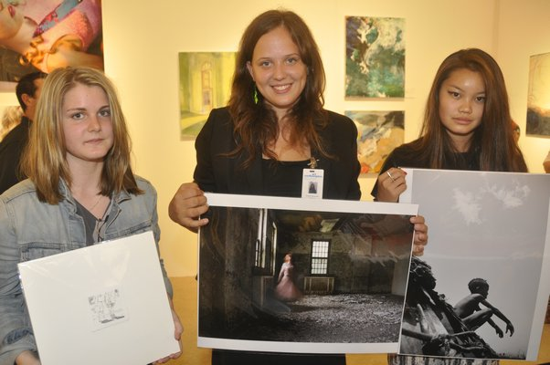 Ross School student artists Issy Cassou, left, Graylen Gatewood and Geige Silver. MICHELLE TRAURING
