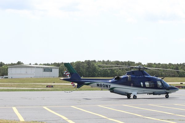 East Hampton Town is in talks with the estate of the late Ben Krupinski to buy out the lease on the East Hampton Executive Terminal hangar at East Hampton Airport.