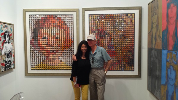 Candice CMC with concert promoter Ron Delsener in front of her iconic donut portraits