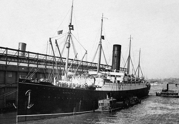 "The ""Carpathia"" docked in New York following the rescue of ""Titanic"" survivors."