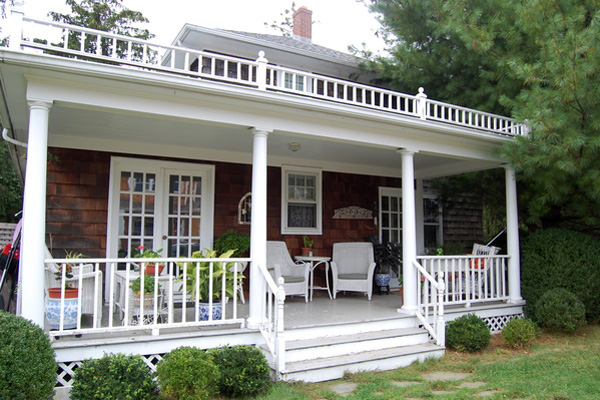 Back porch view of the two-story farmhouse in North Havenm which Gayle Ratcliffe would rather give away than have to tear down.
