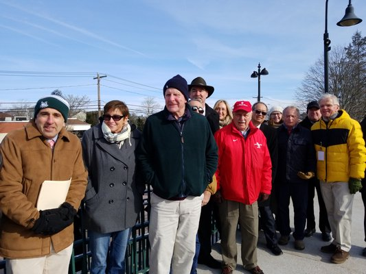 State and local officials met with Long Island Rail Road officials at the Hampton Bays train station on Friday to announce March 4 as the official start date of the South Fork Commuter Connection. GREG WEHNER