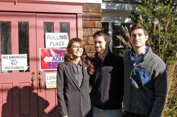 First Congressional District Democratic candidate Anna Throne-Holst heads into the Community Bible Church of Sag Harbor with her sons Max and Sebastian to cast her vote on Election Day.  DANA SHAW