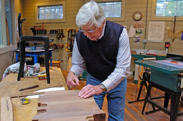 Tom McCormick in his workshop in East Quogue.      DANA SHAW