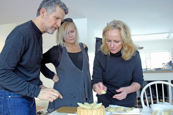 Photographer Steven Rothfeld, Barbara Barrielle and cookbook author Hillary Davis work to set up a shot for the book.  DANA SHAW