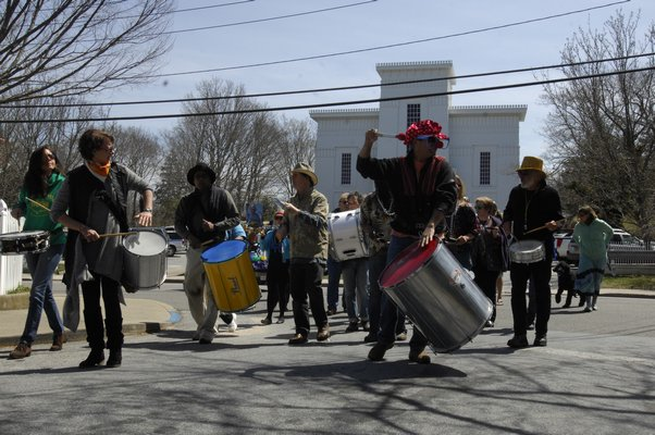 April 24 -- A gathering and a stroll was held through Sag Harbor in honor of Vivian Walsh of Vivian and the Merrymakers, who passed away earlier in the month. About 30 people including members of Escola de Samba Boom participated in the celebration.