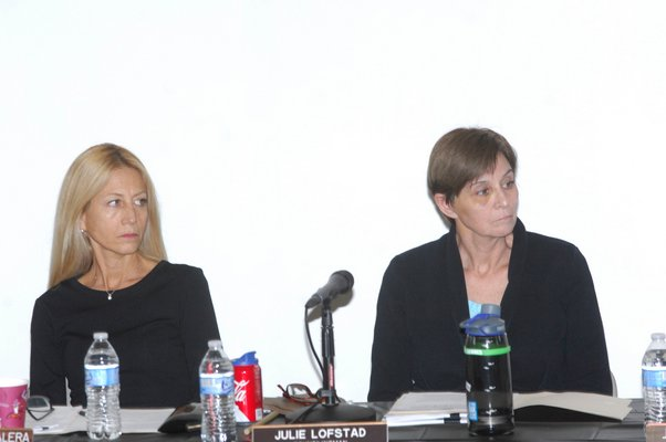 Town Board members Christine Scalera and Julie Lofstad at Tuesday's meeting.  DANA SHAW