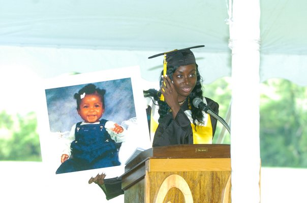 Bridgehampton Salutatorian Nia Dawson with a photo of herself as a baby.