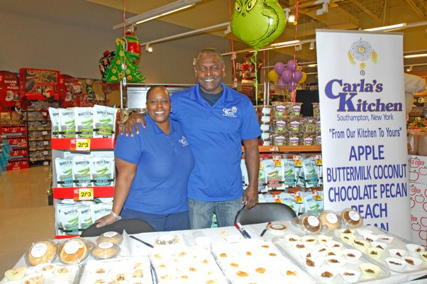 """Carla James and Antonio during the """"roll out"""" of her pies at the Riverhead Stop and Shop on Friday afternoon. DANA SHAW"""