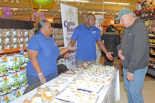 """Carla James, founder of Carla's Kitchen during the """"roll out"""" of her pies at the Riverhead Stop and Shop on Friday afternoon.  DANA SHAW"""