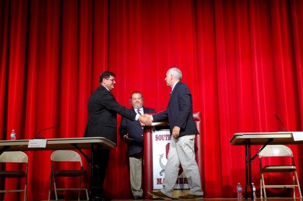 Southampton Town Supervisor candidates Richard Yastrzemski and Jay Schneiderman shake hands after Monday night's debate.  DANA SHAW