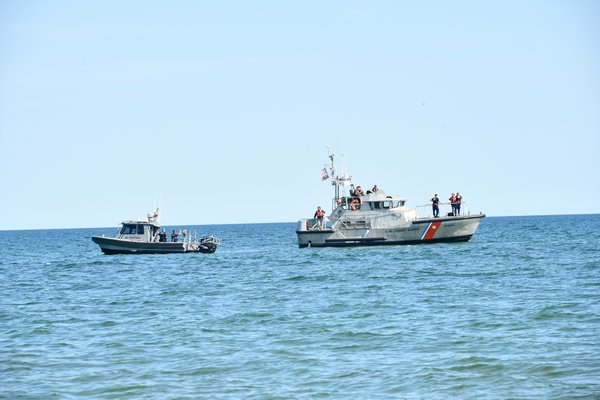 The bay constable and the Coast Guard resopnd to a whale entagled in a net off Town Line Road in Sagaponack.  DANA SHAW