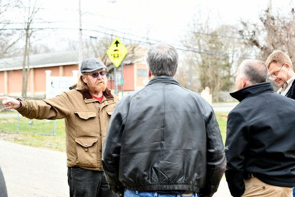 Terry Flanagan of Flanders, left, confronts officials from PSEG about the osprey nest on Tuesday.  DANA SHAW