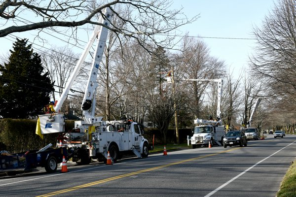Crews work on lines in Southampton Village.  DANA SHAW