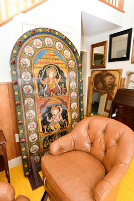 A bit of old India found its way to the benefit sale in the form of a painted Ganesha (Hindu god of transitions) door. Ganesha is often found near or on doors throughout India.  DANA SHAW