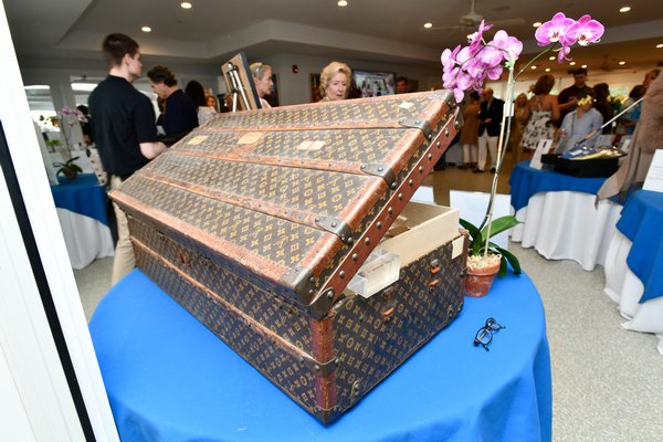 After the furniture sale portion of the event there was a live auction with items like this vintage Louis Vuitton trunk, which had an opening bid of $4,000! DANA SHAW