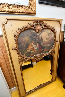 The type of mirror one doesn't see every day because they're rare: French trumeau mirrors feature a painting, usually a romantic scene, above the actual mirror and both are set off with lots of gilded moldings as this one is.  DANA SHAW