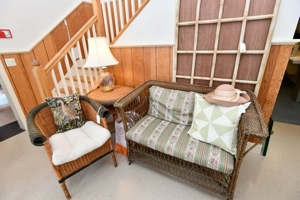 Fine antique wicker and rattan loveseat, chair and table most likely Wakefield from the late 19th century or early 20th century.  DANA SHAW