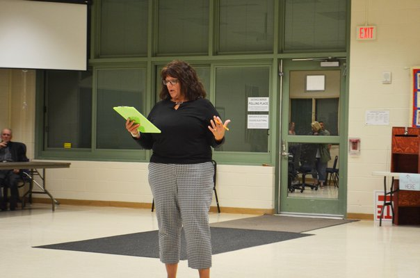 Eastport-South Manor District Clerk Sharon Murray announcing the voting results for the budget. ANISAH ABDULLAH