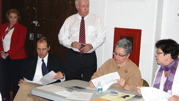 Southampton School District officials and pollworkers gather to record the results: School Board Vice President David D