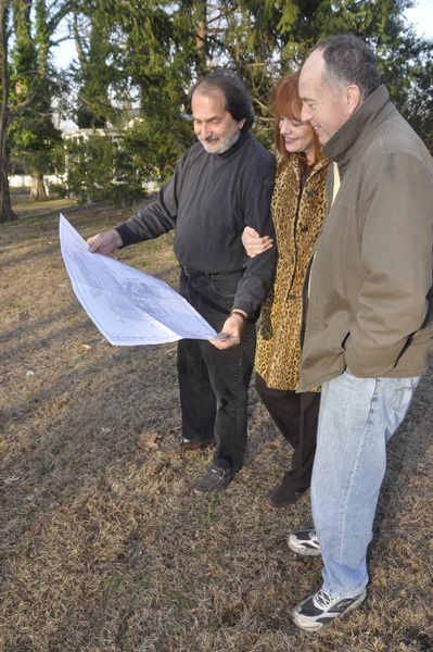 Architect Robert Strada, left, Michelle Murphy Strada and Greg Therriault review the plans. MICHELLE TRAURING
