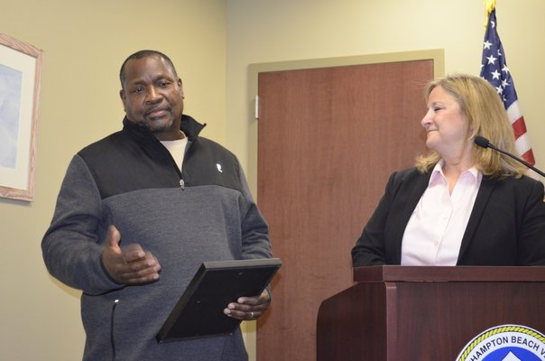 Westhampton Beach DPW Labor Crew Leader Greg Liggon receiving a proclamation for his retirement from Mayor Maria Moore on behalf of the village. ANISAH ABDULLAH