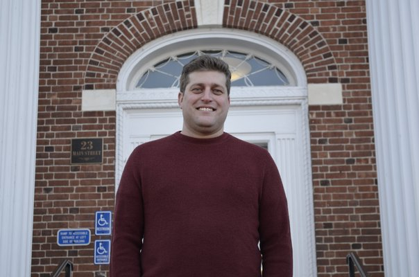 Zachary Epley in front of Southampton Village Hall. ANISAH ABDULLAH