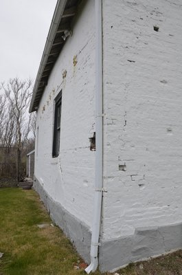 The 1838 Keeper's Quarters at Montauk Point is in need of restoration. Its walls buldge out and its bricks are beginning to crumble. SHAYE WEAVER