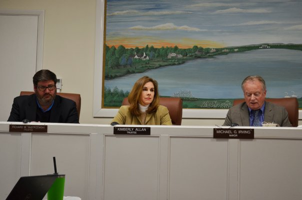 Southampton Village Board members Richard Yastrzemski and Kimberly Allan with Village Mayor Michael Irving at the February 26 board meeting. ANISAH ABDULLAH